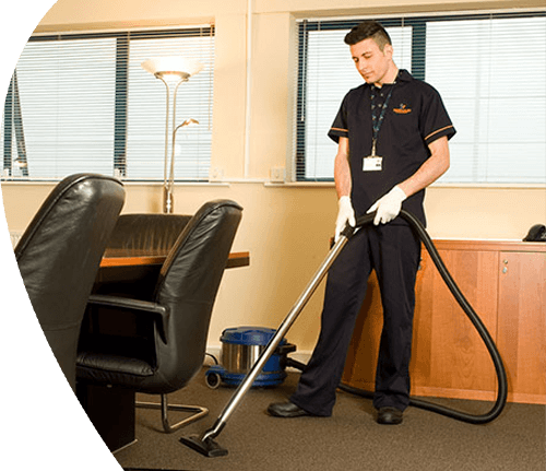 A derrycourt Staff member Cleaning the Office Carpet