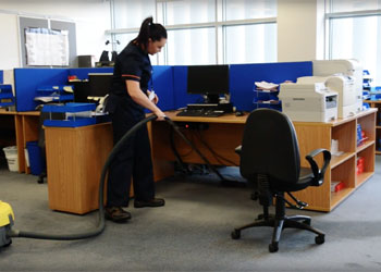 A Staff member cleaning the Office Carpet