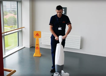A Staff member cleaning the Floor