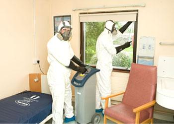 Derrycourt team sanitizing the room